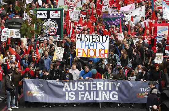 Share International November 2015 images, Thousands of people attended an anti-austerity demonstration outside the annual conference of the UK's governing Conservative Party in Manchester.