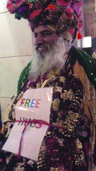 Share International July / August 2016 images, Benjamin Creme's Master confirms that this is Maitreya in colourful guise, offering free hugs.