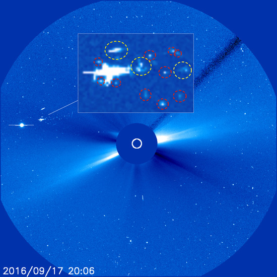 Share International November 2016 images, On 17 September 2016, numerous UFOs of varying shapes were filmed near the sun by NASA's Solar Heliospheric Observatory (SOHO).