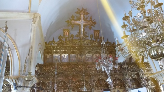 Share International December 2016 images, Photo taken at Panagia Tourliani Monastery on Mykonos, Greece, on 25 May 2016, shows an unusual beam of light.