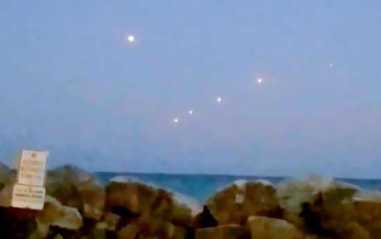 Share International March 2017 images, On 26 September 2016, a witness in the US took a video of a group of brilliant orb-like objects that hovered motionless over Lake Michigan