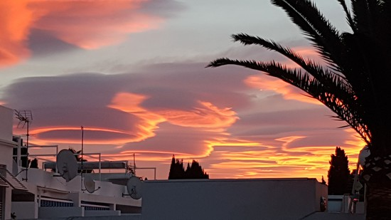 Share International April 2017 images, These gigantic 'cloud UFOs' were photographed over Nerja, Malaga, Spain on 10 January 2017