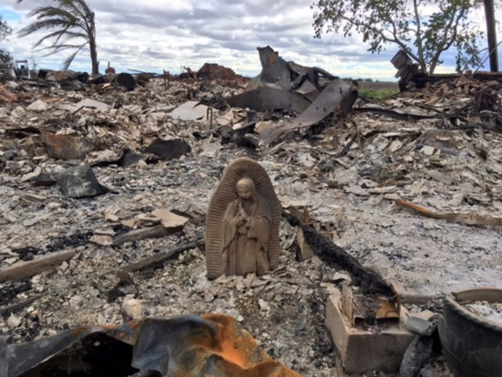Share International November 2017 images, An electrical fire destroyed three houses on a Texas family's property during Hurricane Harvey in August 2017, but their statue of the Madonna remained intact.