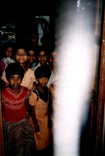 Share International May 2018 images, Pupils at the Brahmana Palli Public School near Sai Baba's Ashram in Puttaparthi, India, in March 2006. Photograph taken by D.M. during a visit that she and friends made to the school, where the children were given presents and showed the visitors their rooms.
