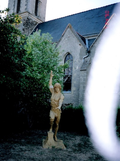 Share International December 2018 images, Photograph taken on 5 September 2005, shows a sculpture made by M.V., in a church garden in Les Cerqueux-sous-Passavant, France. The column of light was confirmed by Benjamin Creme's Master to be a blessing from Maitreya.